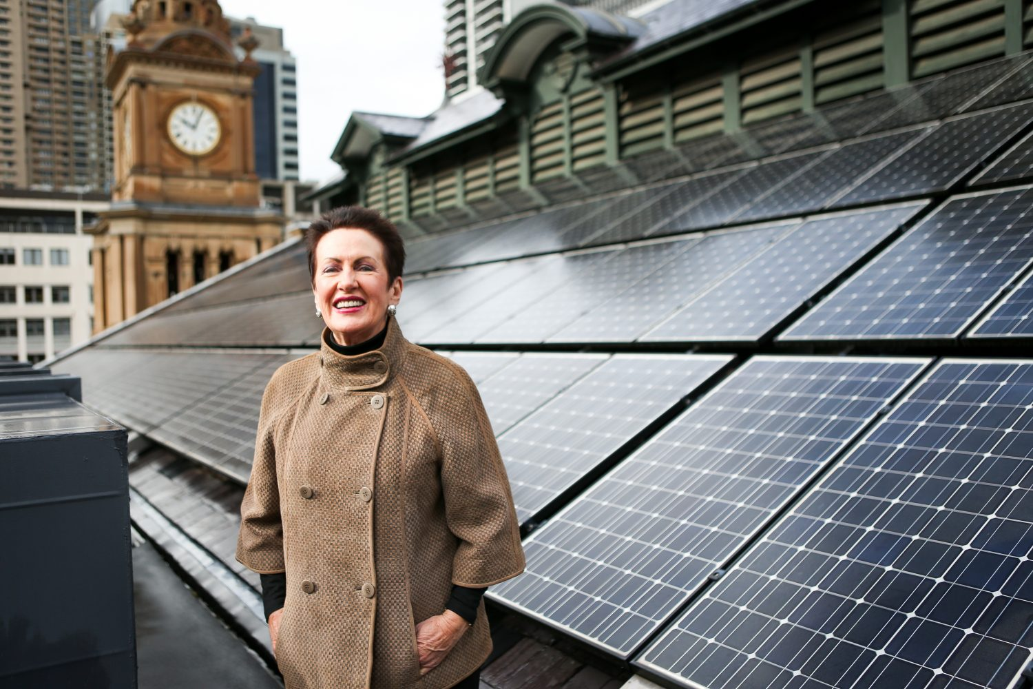 Lord Mayor Clover Moore at Sydney Town Hall with solar panels