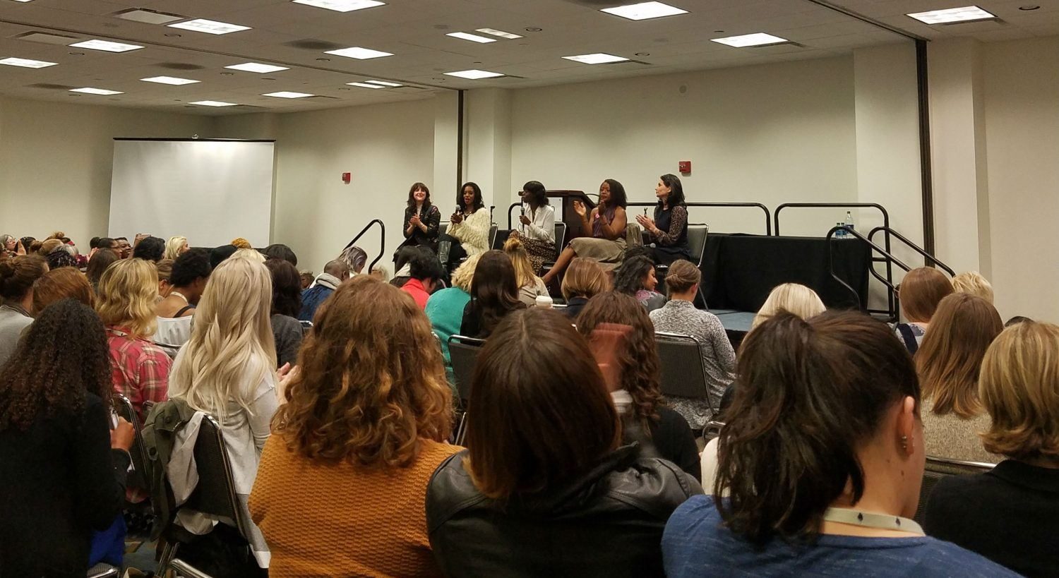 Women business owners and leaders address a packed room at the Women's Convention. (L to R: Piera Gelardi, co-founder of women's media company Refinery29; lifestyle brand owner Arian Simone; discussion leader and serial entrepreneur Dee Poku; designer Tracy Reese; Jennifer DaSilva, president of advertising agency Berlin Cameron.)