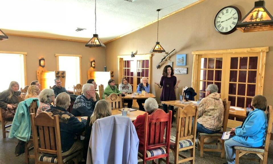 Former congressional candidate Leah Phifer talks with Cass County delegates and DFL party members. (Credit: Leah Phifer campaign page)