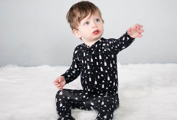 Woman business owner Laura Genova is crowdfunding to launch Deklan Zip Footies, which will sell sustainable, simple baby clothes. (Credit: Deklan Zip Footies Instagram account)