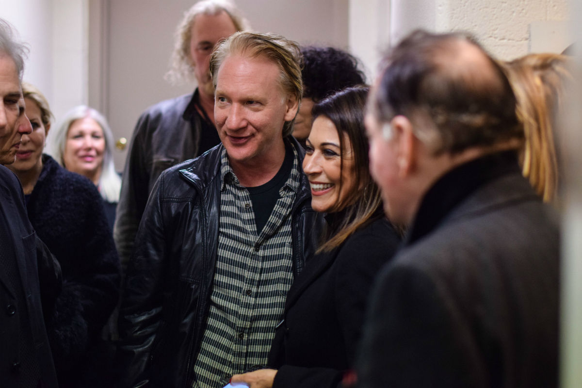 Caroline Hirsch of Carolines on Broadway (right, with comedian Bill Maher) knows how to run a successful comedy club. (Credit: Carolines on Broadway)