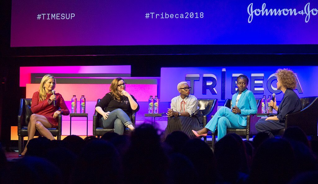 At the 2018 Tribeca Film Festival, the Reclaiming the Narrative panel discussed #TimesUp and sexual harassment in the workplace. (R-L) Mira Sorvino, Amber Tamblyn, Cynthia Erivo, and Lupita Nyong'o took part, and Michaela Angela Davis was the moderator. (Credit: Rhododendrites, Wikimedia Commons)