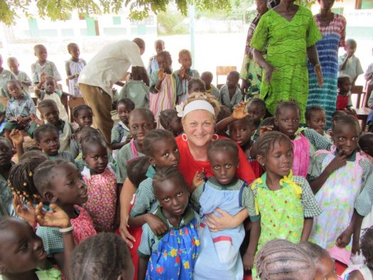 Rachel O'Neill sends bundles of homemade dresses -- and love -- to children in Africa and other countries around the world.