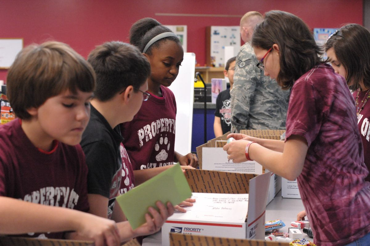 Kids making packages for the troops for Operation Shoebox (Credit: Joint Base San Antonio, Airman 1st Class Alexis Siekert)