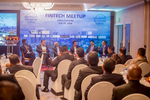 Fintech meetings, like this one in 2018, historically have all men in the room. (Credit: Wikimedia Commons)